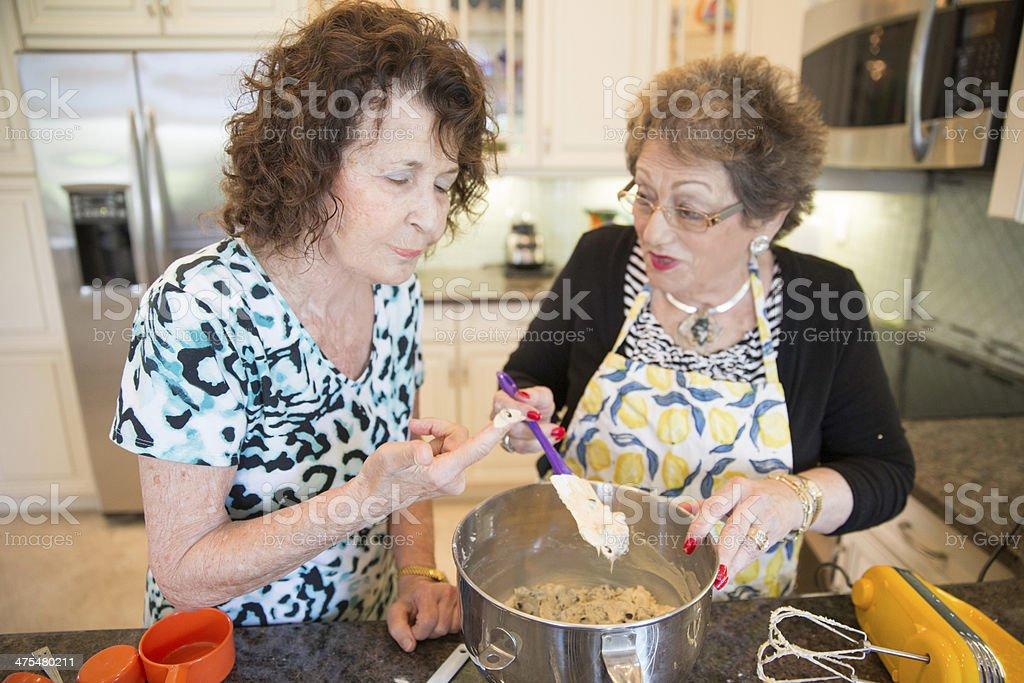 Senior Baking series-tasting batter royalty-free stock photo