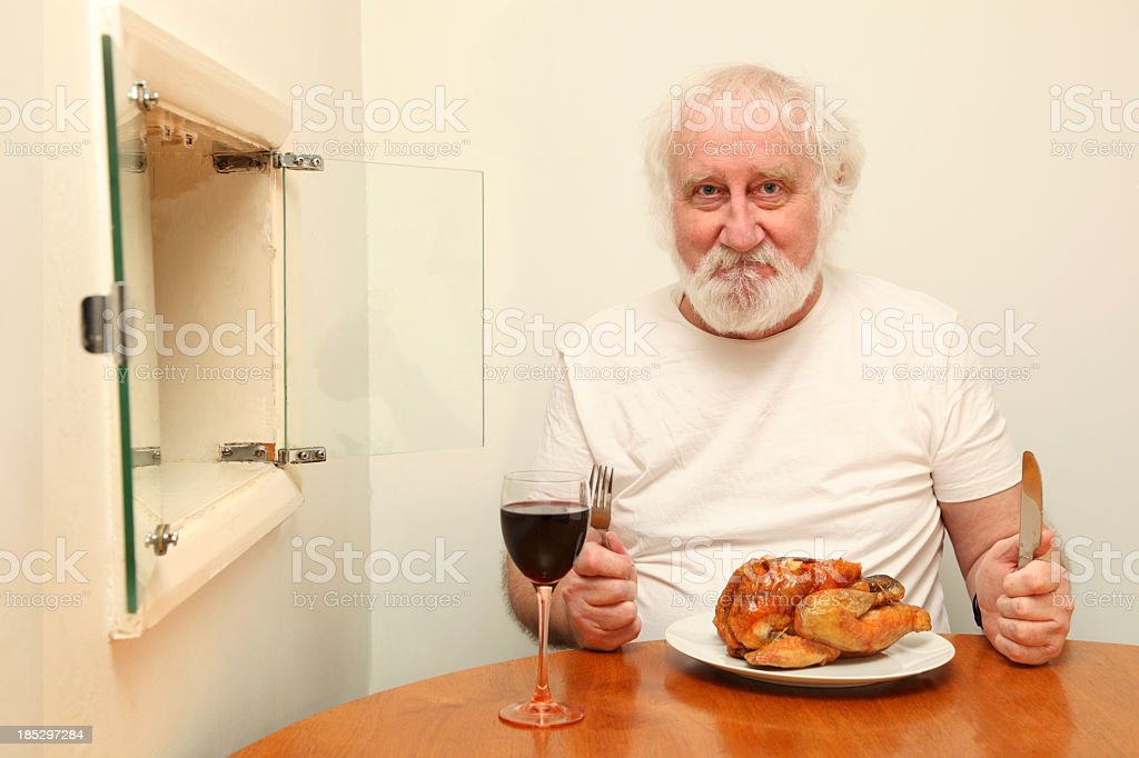 senior bearded male happy at roast chicken meal serving hatch royalty-free stock photo