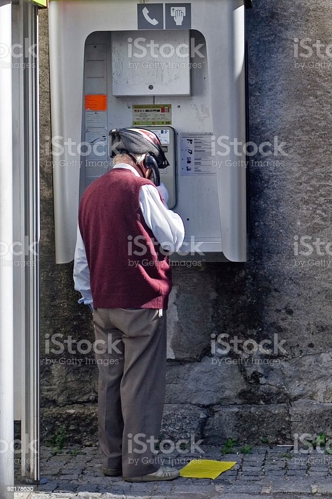 senior biker - telephoning with crash-helmet on head stock photo
