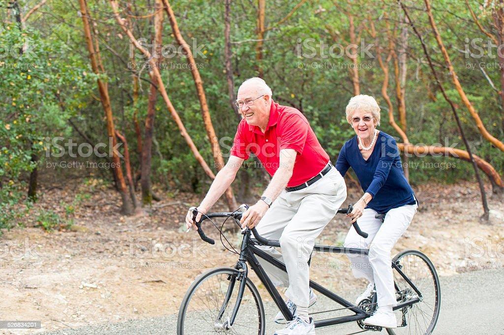 Senior biking stock photo