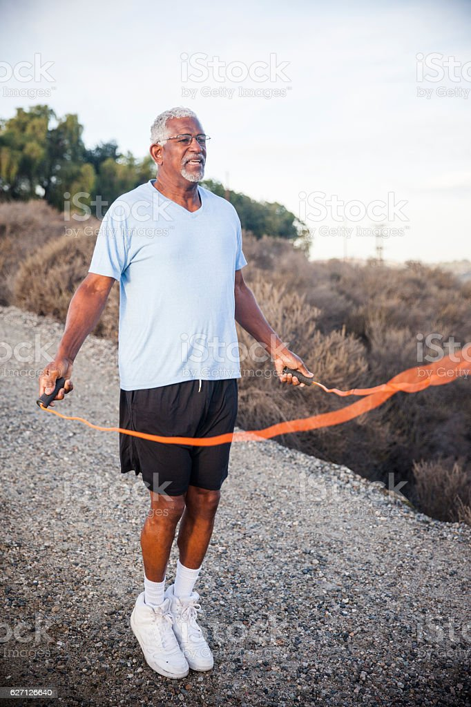 Senior Black Man Jumping Rope Outdoors stock photo