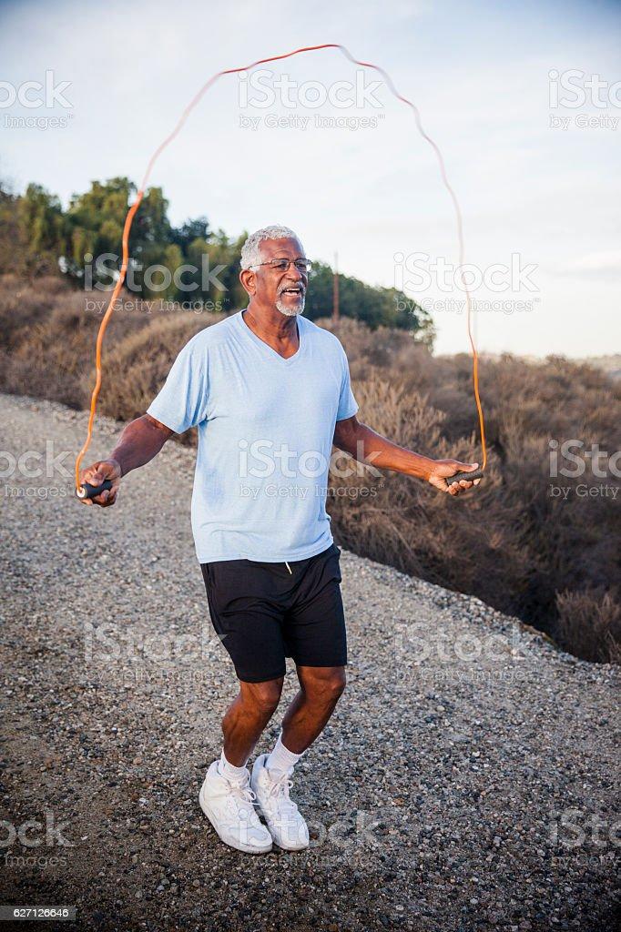 Senior Black Man Jumping Rope Outdoors stock photo