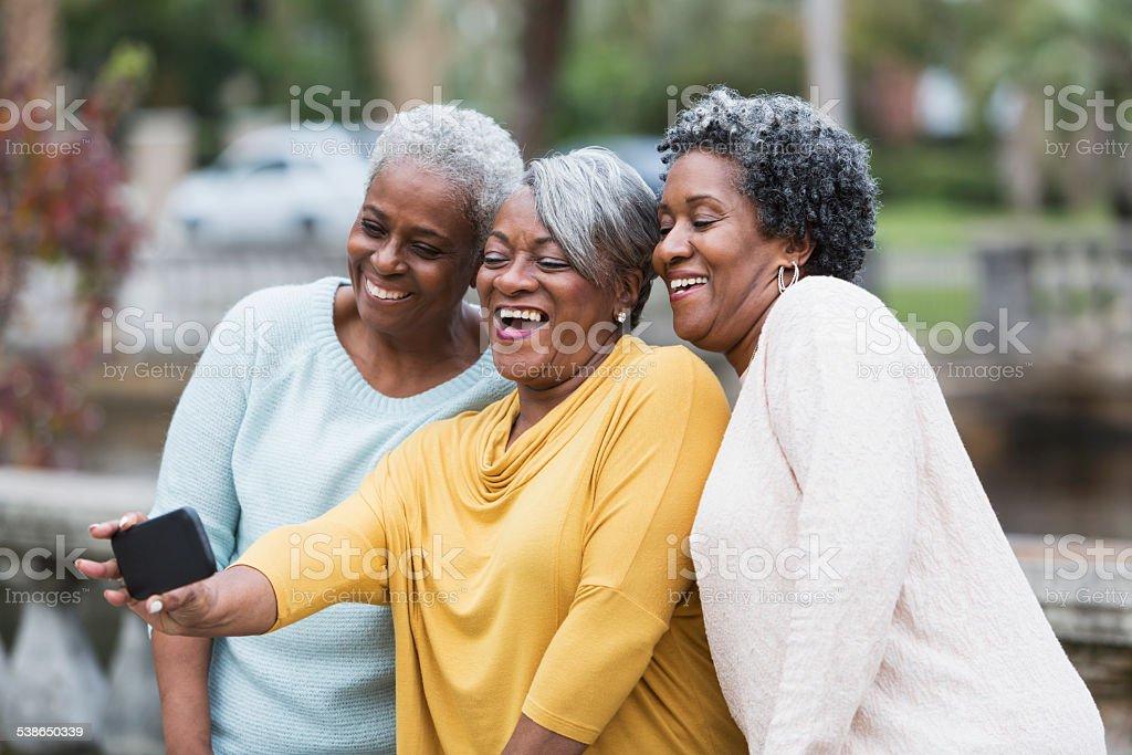 Senior black women taking a selfie stock photo