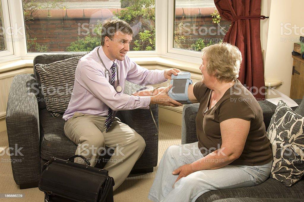 senior blood pressure check royalty-free stock photo