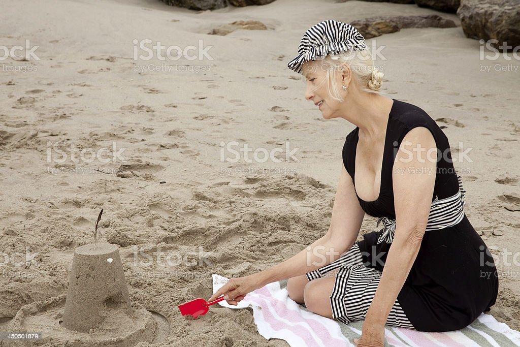 Senior Building Sand Castles royalty-free stock photo