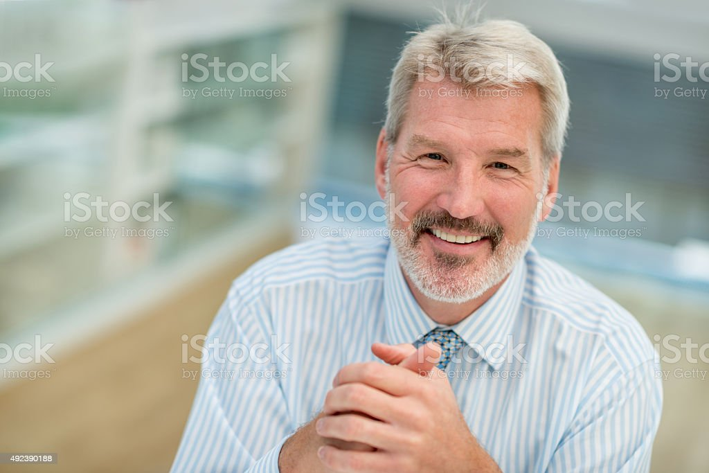 Senior business man at the office stock photo