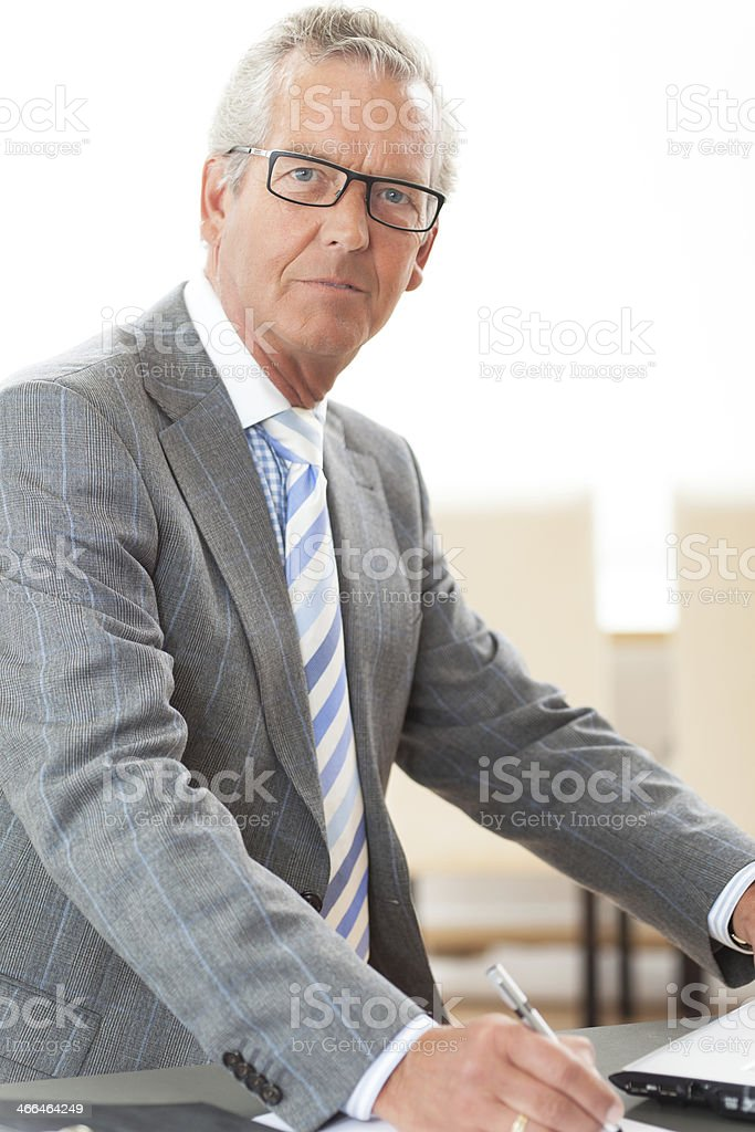 A senior business man in a grey suit stock photo