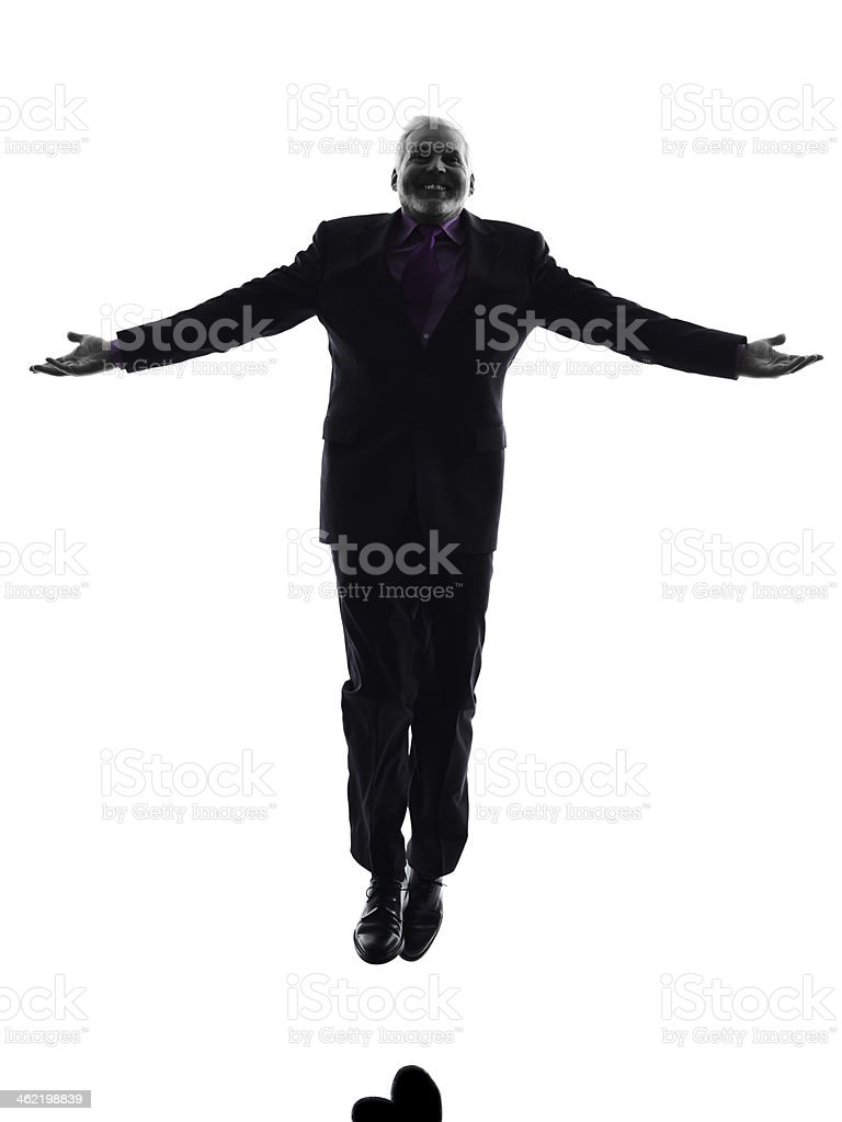senior business man jumping arms outstretched silhouette royalty-free stock photo