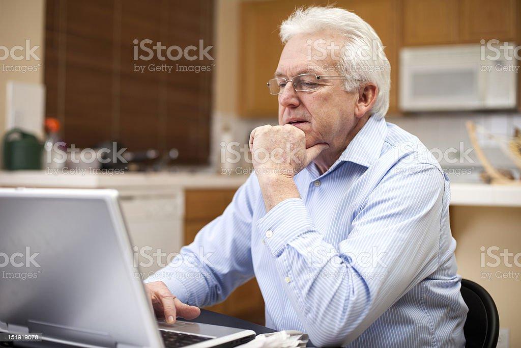 Senior Business Man Preparing Taxes stock photo