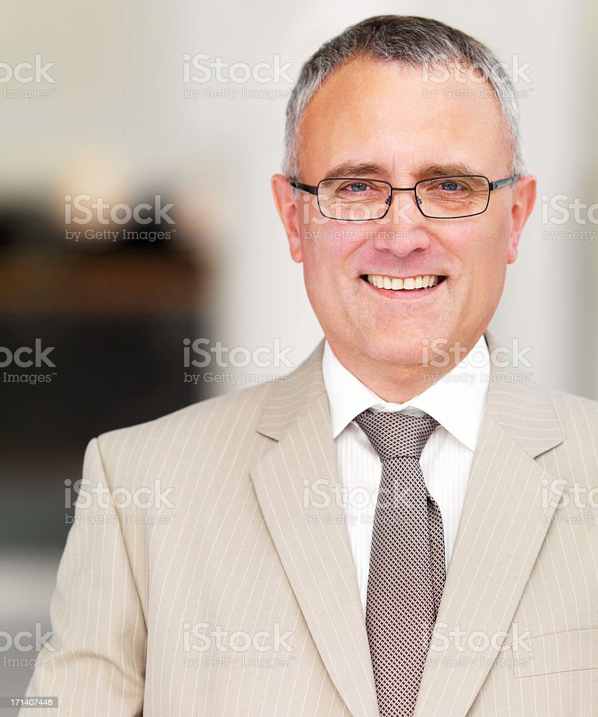 Senior business man smiling royalty-free stock photo