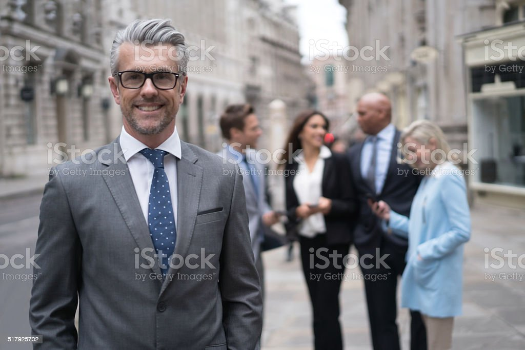 Senior business man with a group stock photo