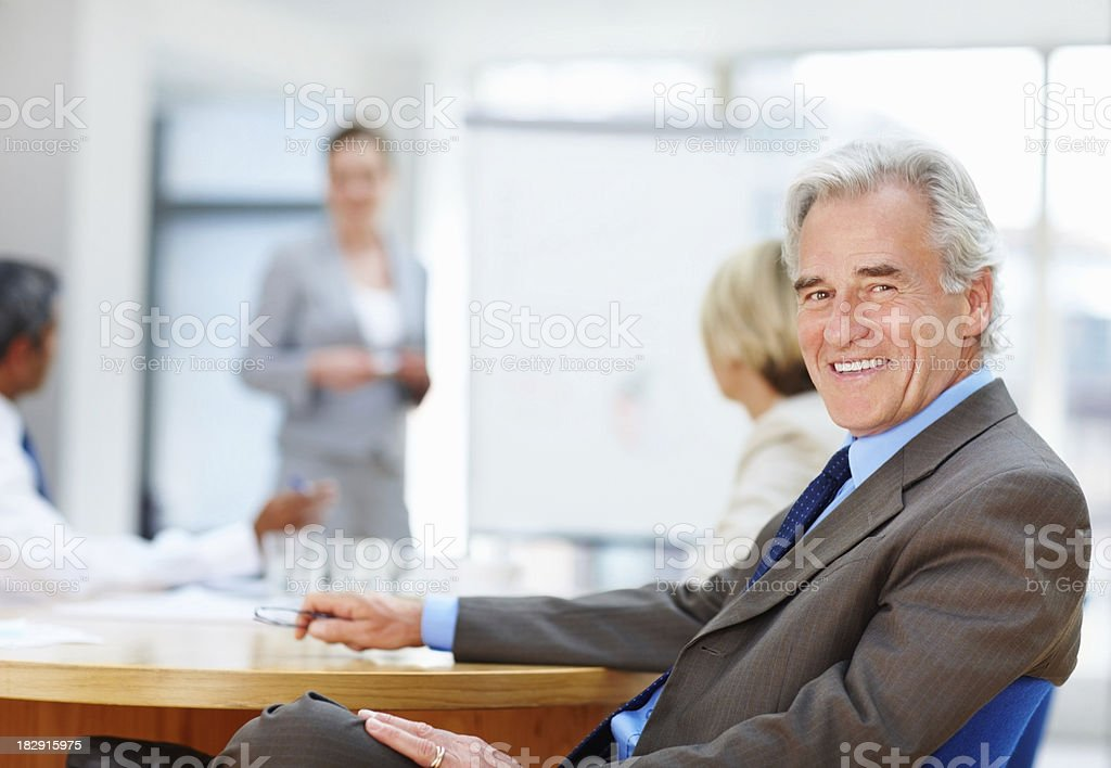 Senior business man with his team during a presentation royalty-free stock photo