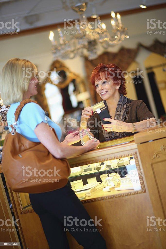 Senior Business Owner Using Credit Card Swiper on Mobile Phone stock photo