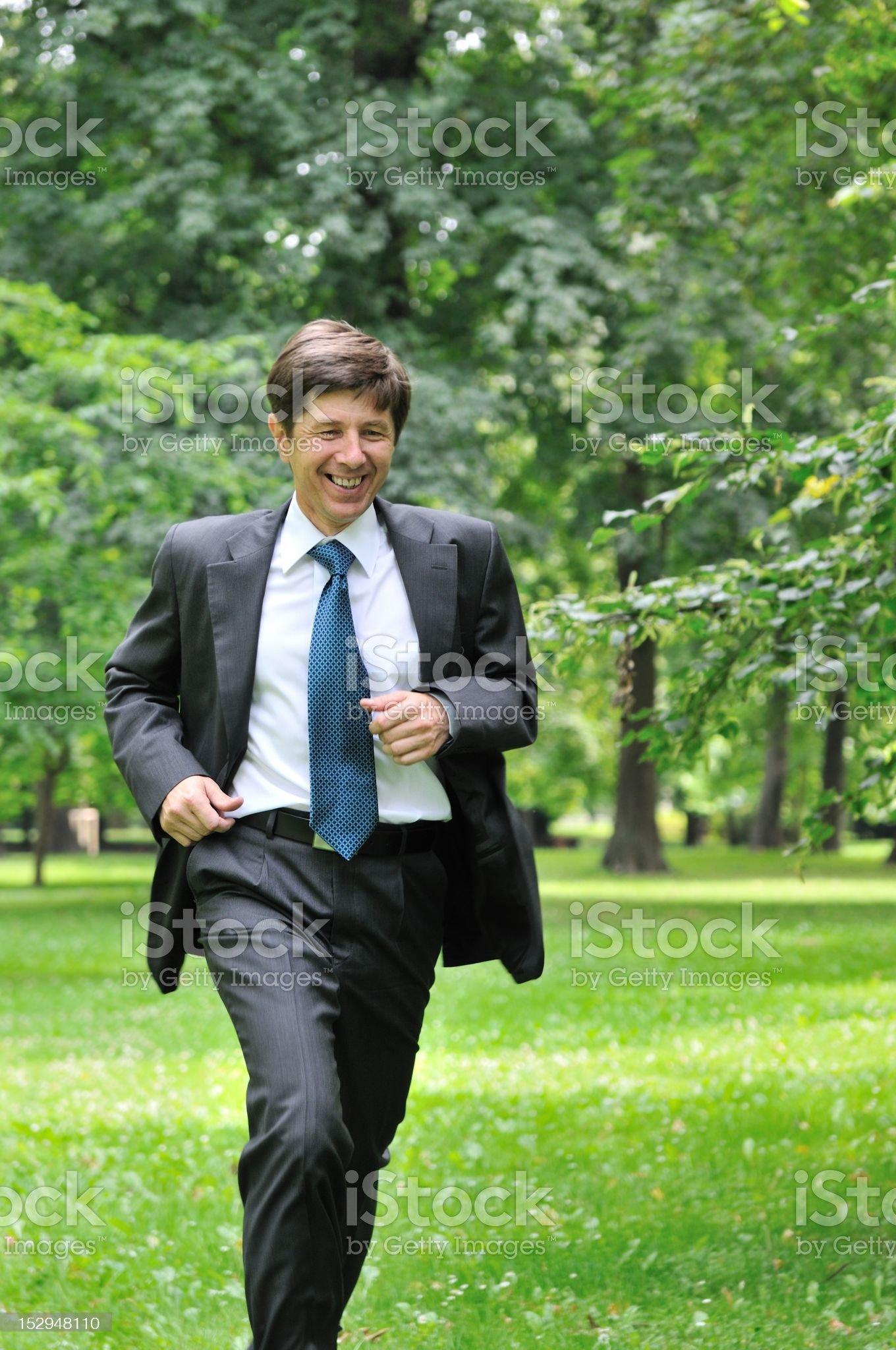 Senior business running in nature royalty-free stock photo