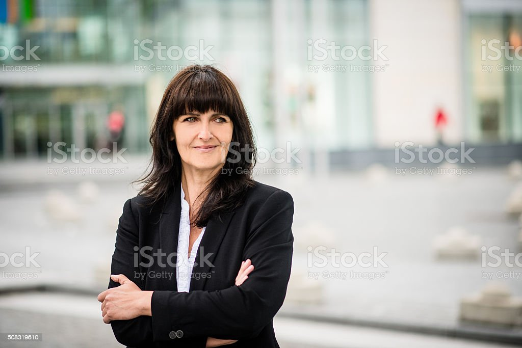 Senior business street woman portrait stock photo