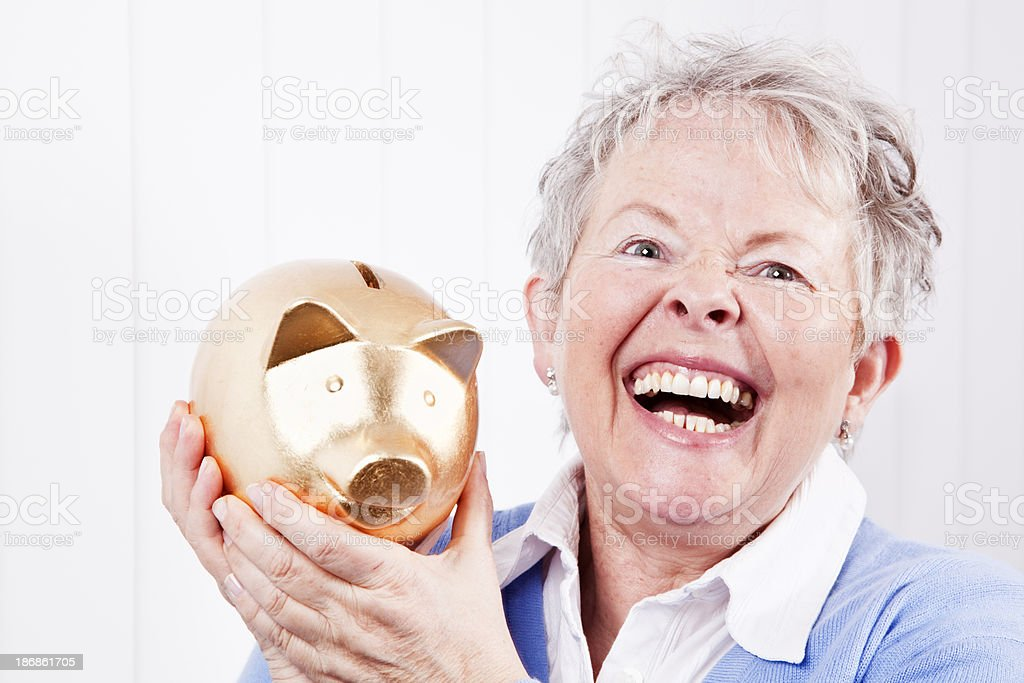 senior business woman and piggy bank royalty-free stock photo