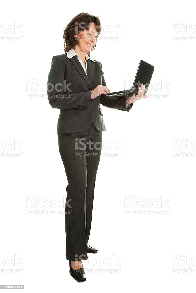 Senior business woman using laptop royalty-free stock photo