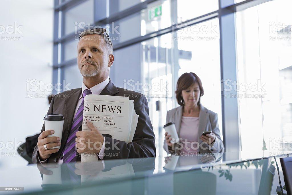 Senior businessman at start of work day royalty-free stock photo