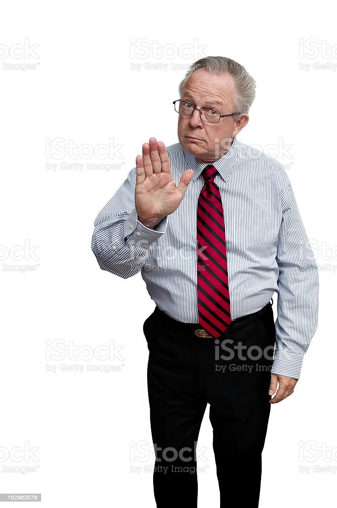 Senior Businessman Authority Figure Giving Hand Stop Gesture royalty-free stock photo