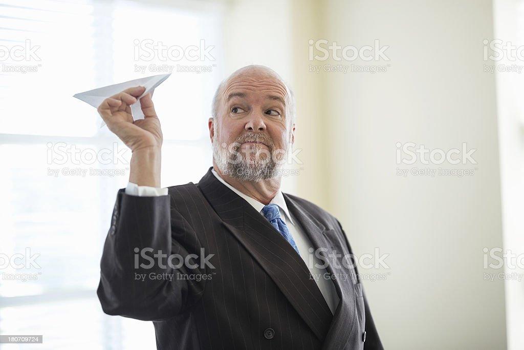 Senior Businessman Flying Paper Plane royalty-free stock photo