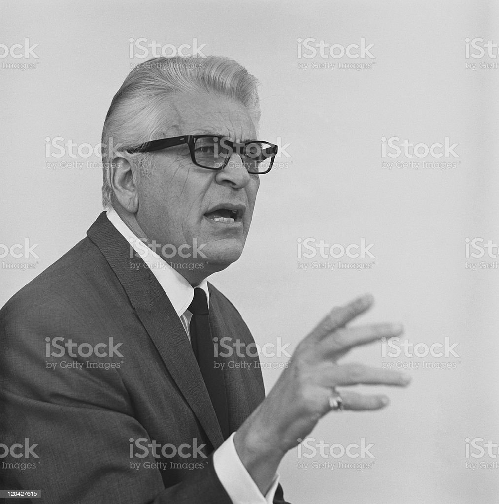 Senior businessman gesturing against white background royalty-free stock photo