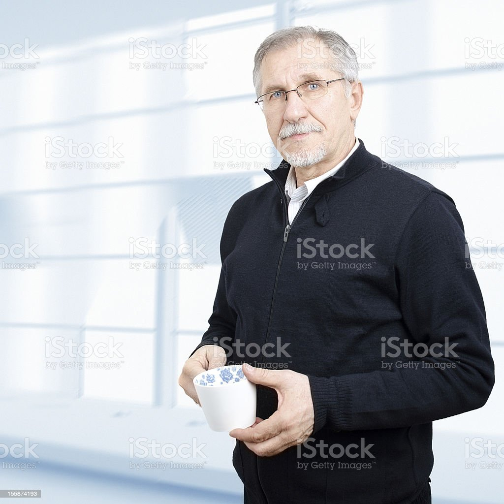 Senior businessman having a cup of coffee stock photo