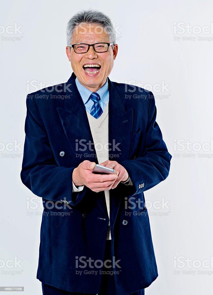 senior businessman holding a smart phone stock photo