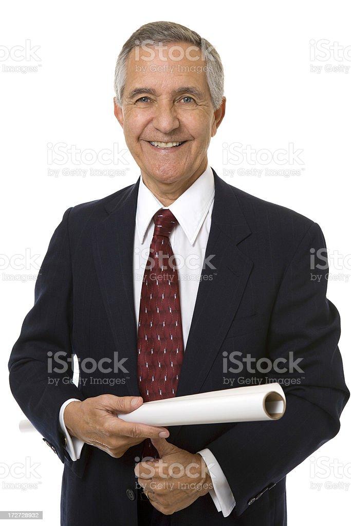 Senior businessman holding architectural plans stock photo