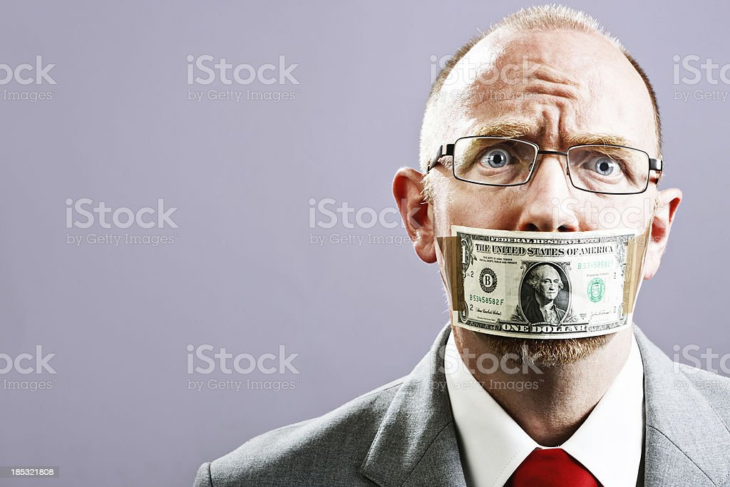 Senior businessman in dollar gag fears and resents being silence stock photo