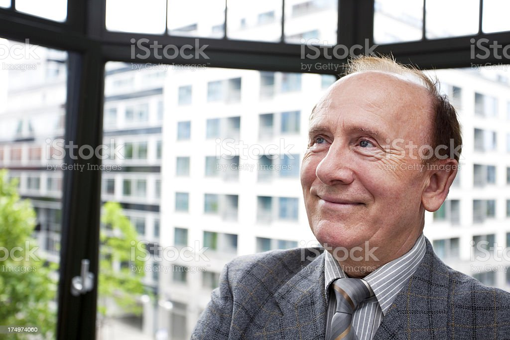 Senior Businessman in Front of Office Window royalty-free stock photo