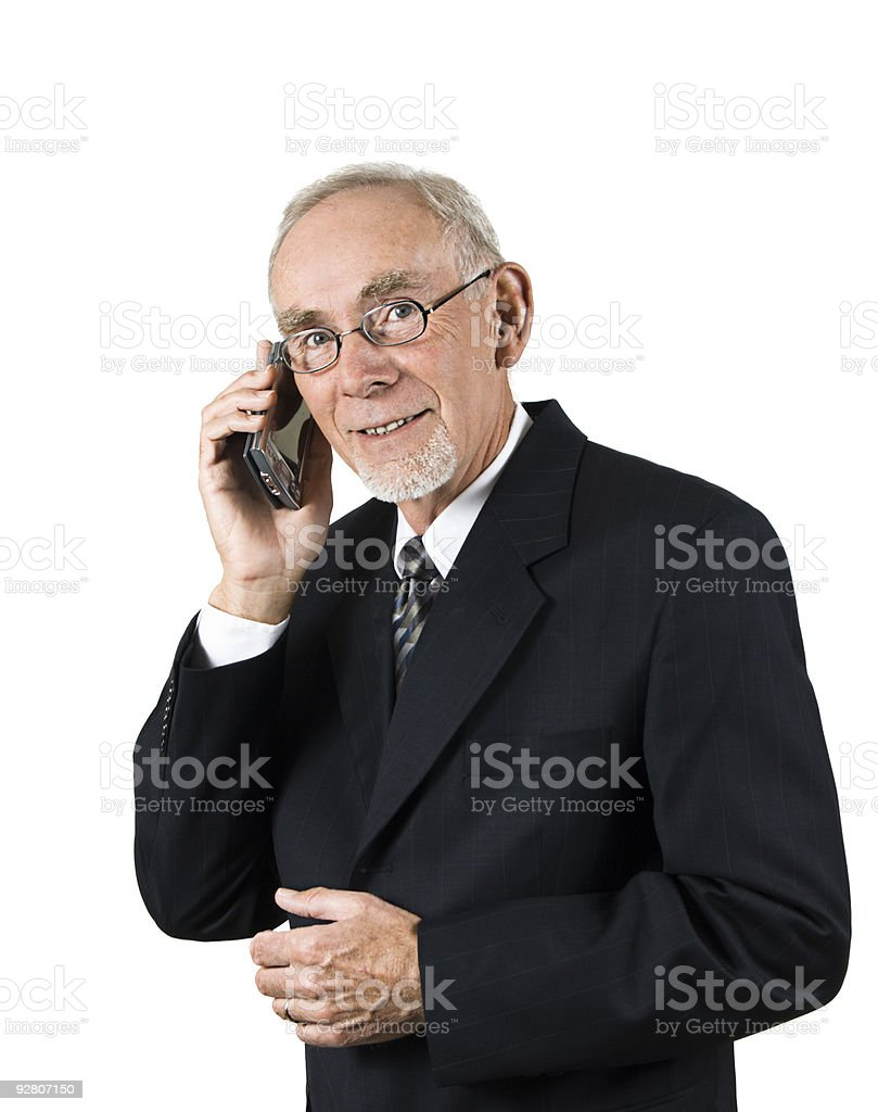 Senior businessman on cellphone stock photo