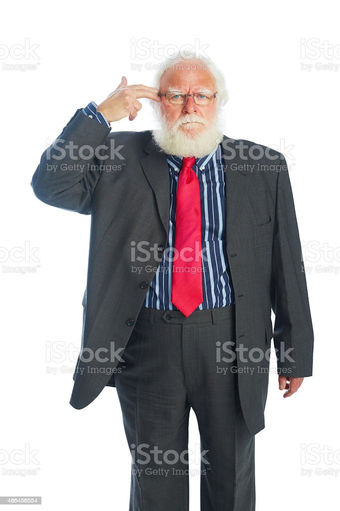 Senior businessman pretending to blow up his head stock photo
