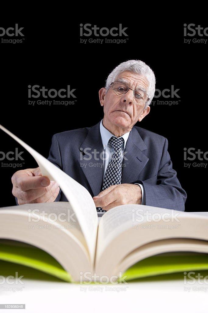 Senior businessman reading a book royalty-free stock photo