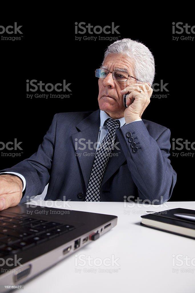 Senior Businessman talking at the cellphone royalty-free stock photo