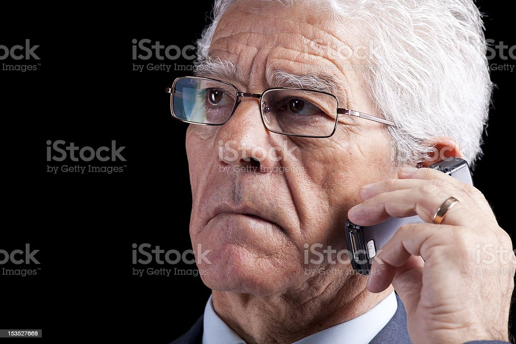 Senior Businessman talking at the cellphone royalty-free stock photo
