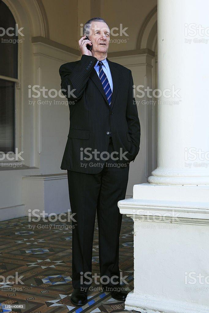 Senior businessman talking on mobile phone royalty-free stock photo