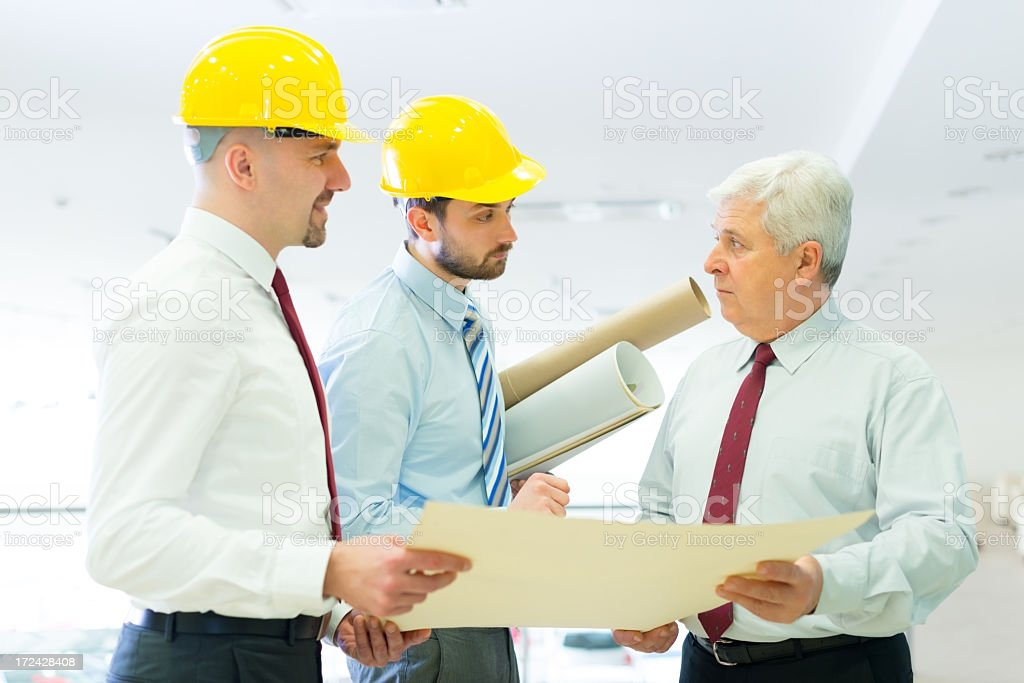 Senior businessman talking to contractors royalty-free stock photo