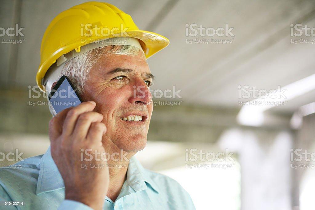 Senior businessman using mobile phone.. stock photo