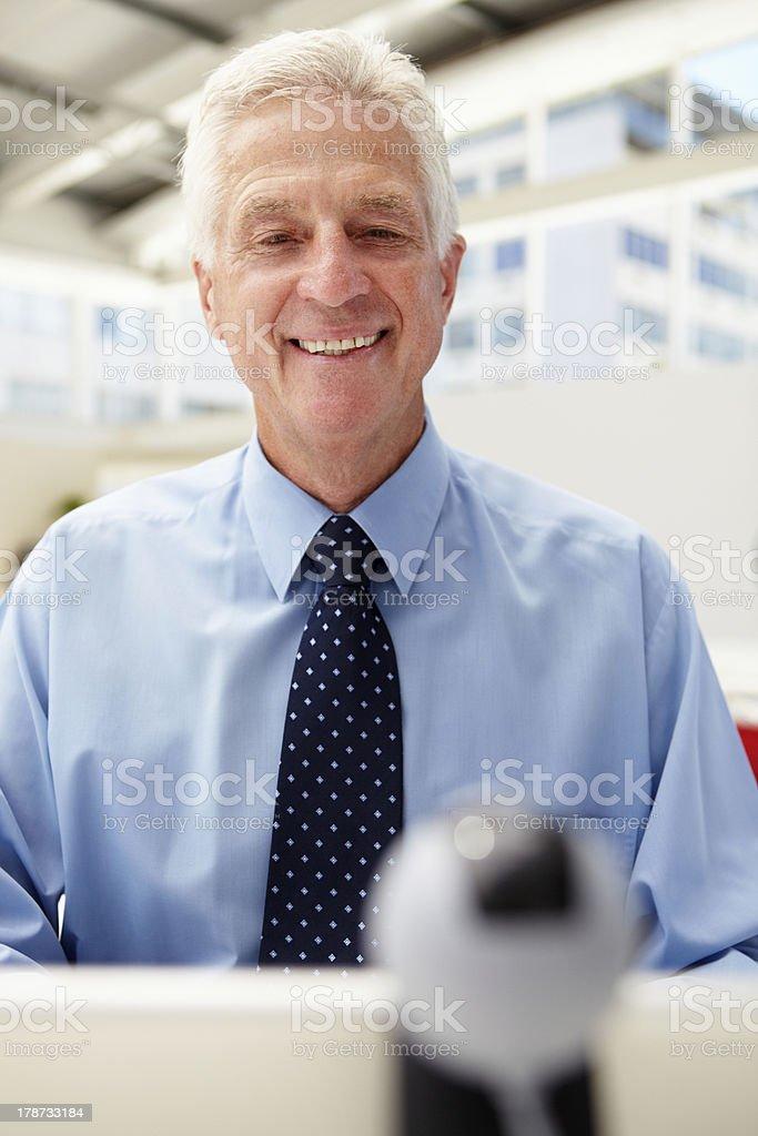 Senior businessman using skype stock photo