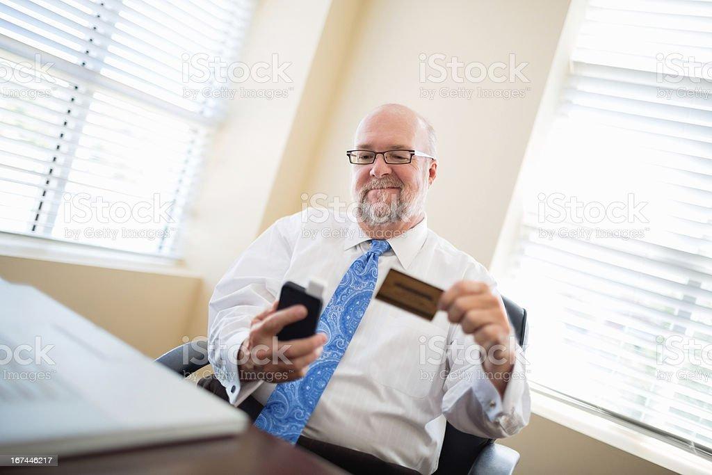 Senior Businessman Using Smart Phone stock photo