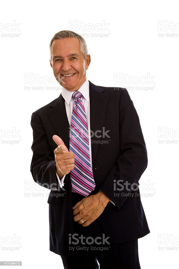 Senior businessman wearing a business suit gesturing gun sign stock photo