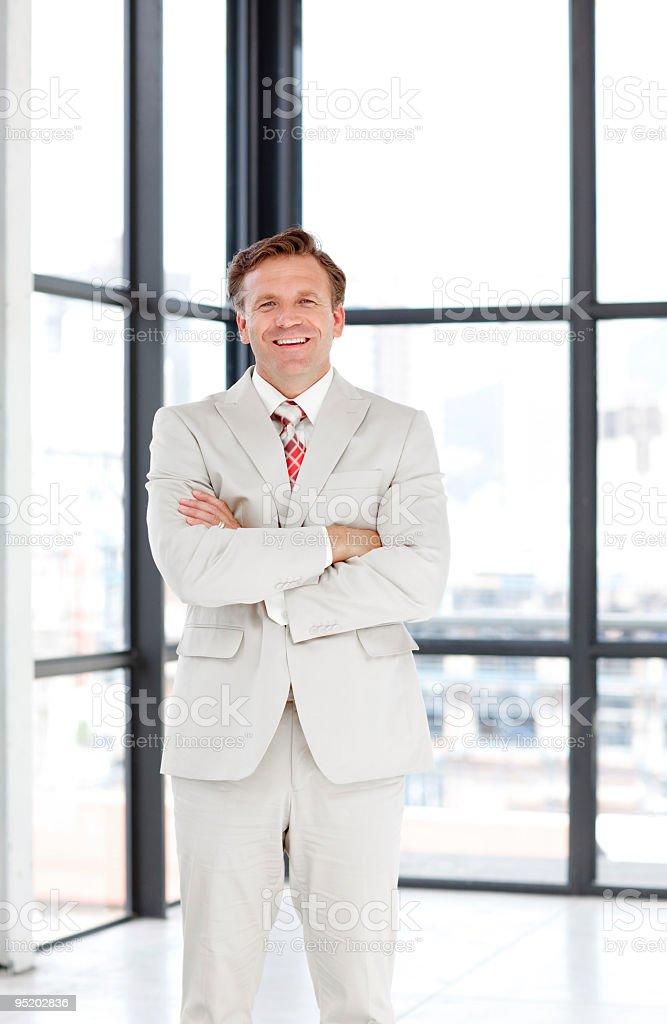 Senior businessman with folded arms royalty-free stock photo