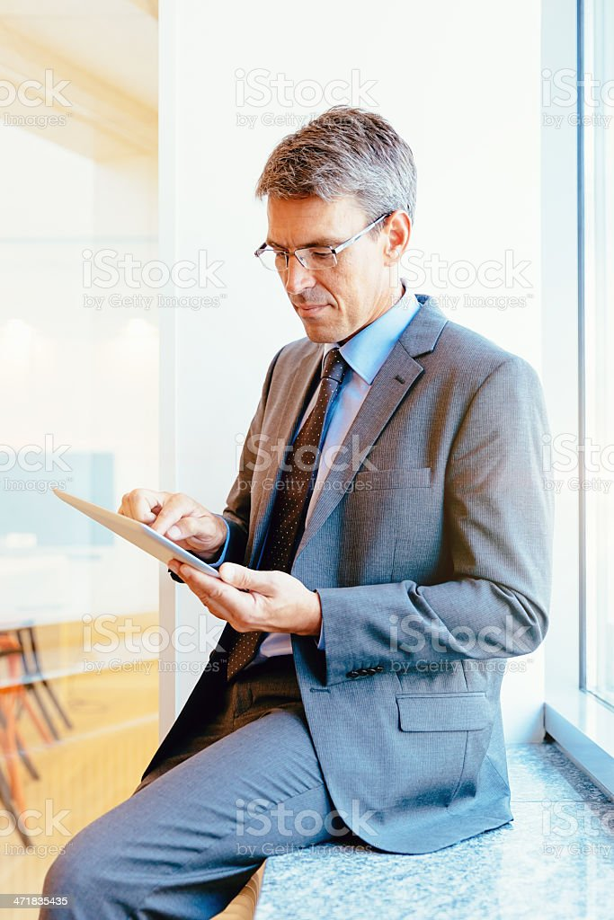 Senior Businessman with Touchpad Modern Office royalty-free stock photo