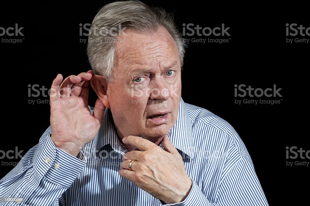 Senior Businessman Wondering What He Just Heard royalty-free stock photo