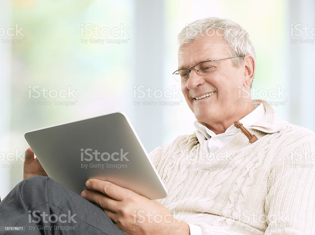 Senior Businessman Working At Home stock photo
