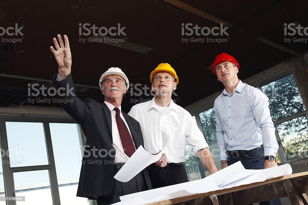 Senior businessmen at construction site royalty-free stock photo
