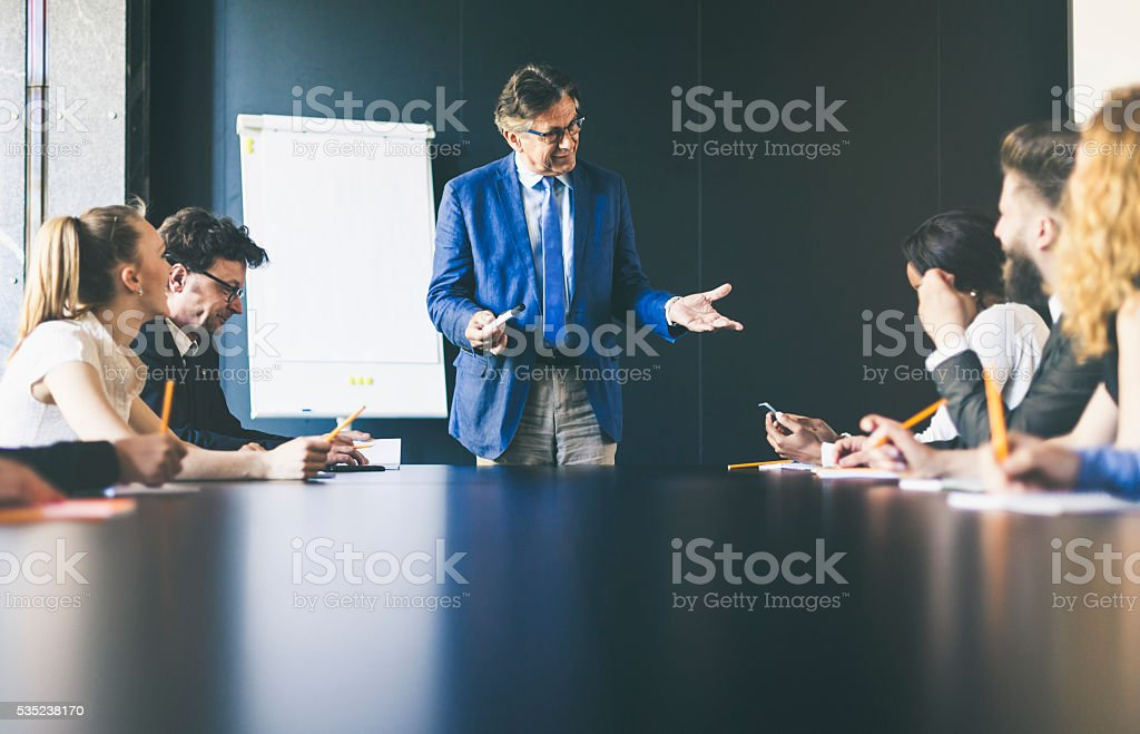 Senior businessmen giving a presentation stock photo