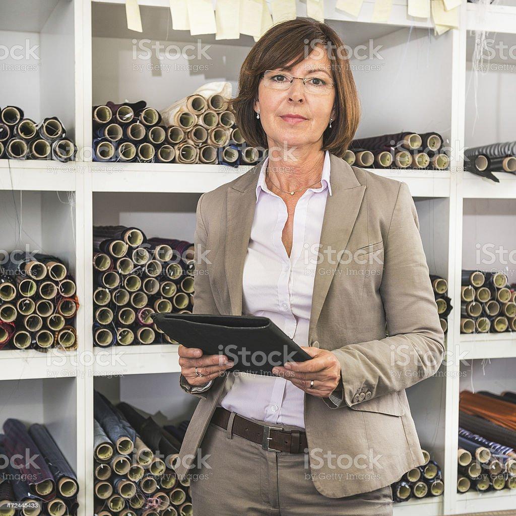Senior businesswoman boss portrait with digital tablet royalty-free stock photo