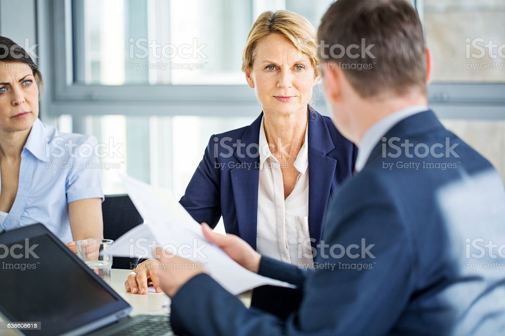 Senior businesswoman during a staff meeting stock photo