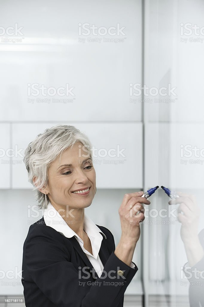 Senior businesswoman giving presentation royalty-free stock photo